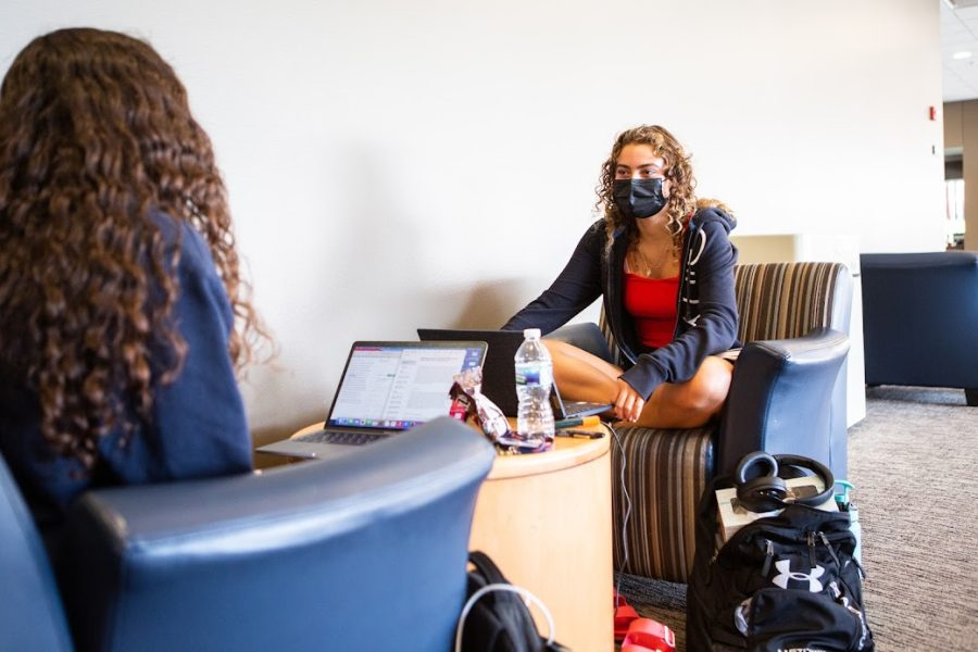 Nora Rafaty and Hulya Goodwin, students in LAS, study in the upstairs lounge of Ikenberry Commons on Sept. 18 while wearing masks. Many students share a concern with COVID-19 being spread around in-person classes.