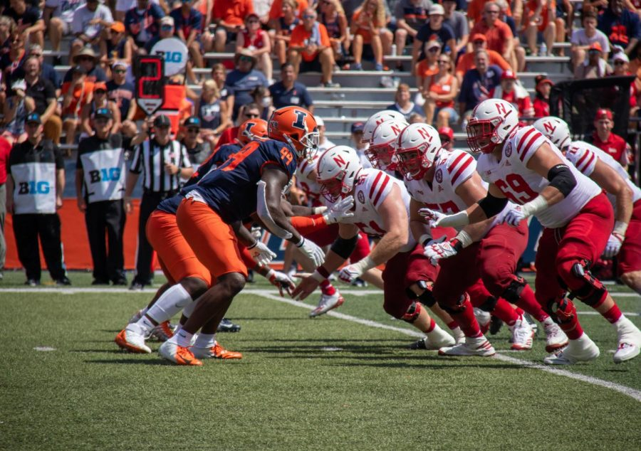 The Illinois defensive line prepares for a snap during the game against Nebraska on Aug. 28. Defensive consistency has been a major issue for the Illini, as they have allowed an average of over 33 points per game this season.
