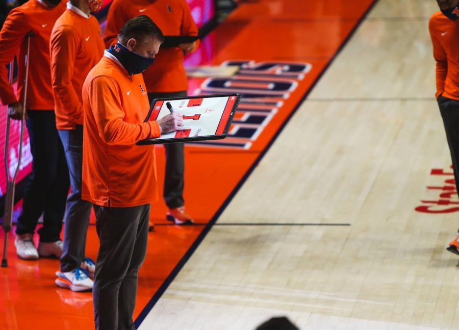 Head coach brad Underwood writes on his whiteboard before the game against Purdue on Jan. 2. Underwood is expected to receive a contract extension through the 2026-2027 season.