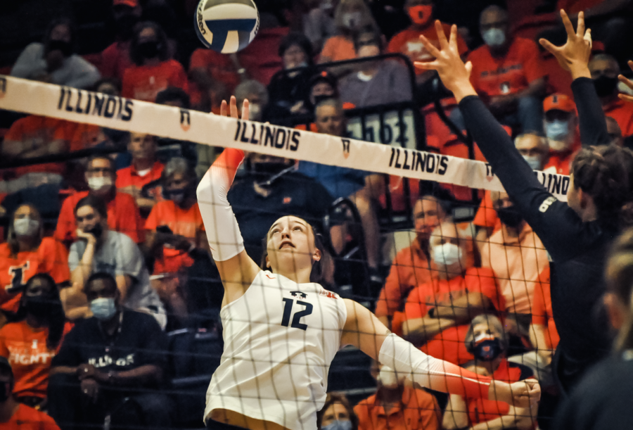 Outside hitter Raina Terry spikes the ball during the game against  Northwestern Sept. 25. The Illini face a challenging weekend against Purdue and Wisconsin.
