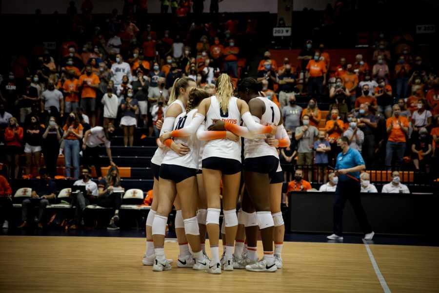 Illinois huddles as a team during the match against Washington on Friday. The Illini fell in both matches, which were part of the Big Ten/Pac-12 Challenge.