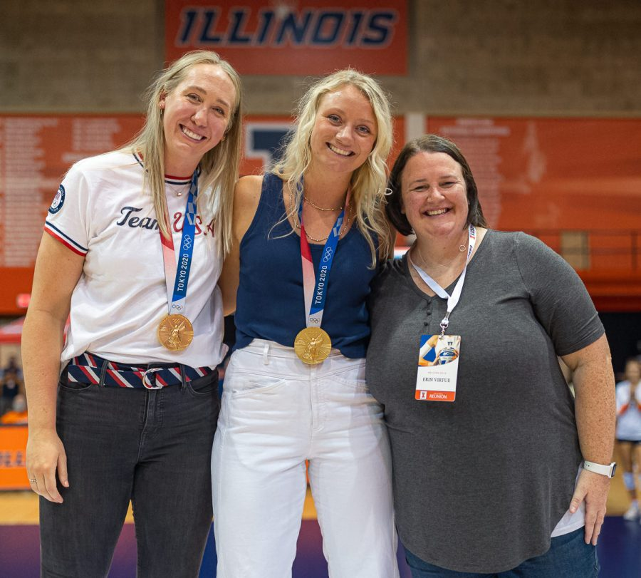 Illini volleyball alumni and olympic athletes Jordyn Poulter, Michelle Bartsch-Hackley and Erin Virtue pose for a photo at Huff Hall on Friday. The olympians reflect on their gold medal win.
