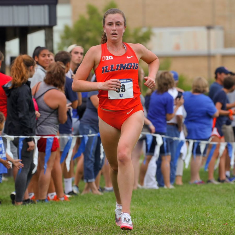Junior Katie Hohe runs during a meet. The teams continue with their strong start as they compete this weekend at the Red Bird Invitational.