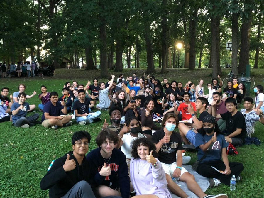 Members of the Astro-biology club sit in a park during a social event. The Alien club, an extraterrestrial themed RSO, questions and discusses a series of topics about conspiracy theories.