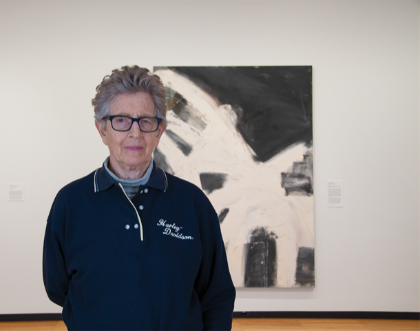 Louise Fishman, who received her M.F.A. in painting and printmaking from the University in 1965, poses in front her painting during a campus visit in 2019. Fishman passed away this July only a month before Krannert Art Museums newest exhibit dedicated to her work was set to open.