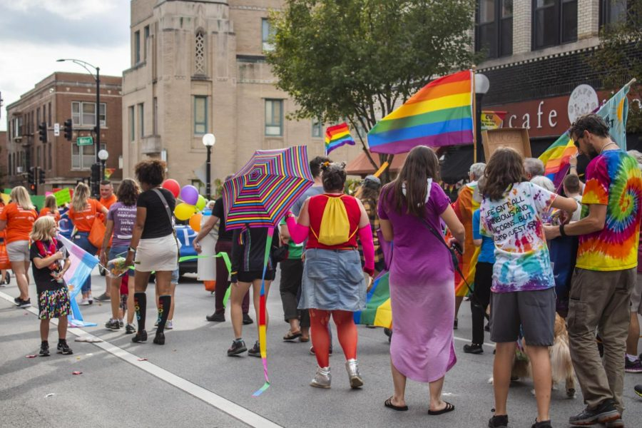 A group of people in rainbow colored clothing line the streets of Downtown Champaign during the Pride parade on Sept. 28, 2019. Committee members at Uniting Pride of Champaign County have been hard at work setting up this years Pride parade set to happen on Saturday.