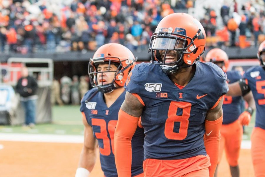 Illinois cornerback Nate Hobbs celebrates a fumble recovery and touchdown during the game against Rutgers.  Hobbs will be playing his rookie season with the Las Vegas Raiders in the NFL.