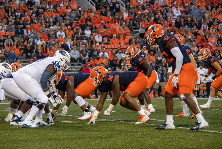 Illinois defensive line prepares for a snap during the game against University of Texas at San Antonio at Memorial Stadium. The Illini struggled to contain a potent running back in Sincere McCormick and gave up too many long passing plays to Zakhari Franklin.