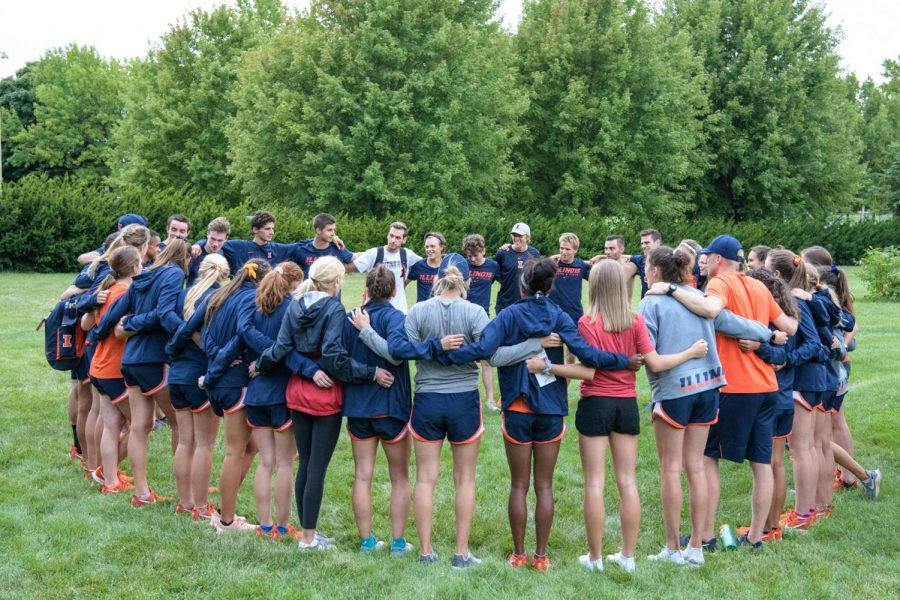 Mens and womens cross country teams huddle up during their first meet in Walt Crawford Open at Eastern Illinois on Sept 3. The season has now started for both teams and they both are off to a strong start.