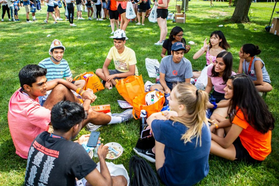 Students congregate without masks during the Welcome celebration in Lot 31 after new student convocation on Aug. 20. Covid-19 cases have begun to decrease after the initial surge at the start of the semester.