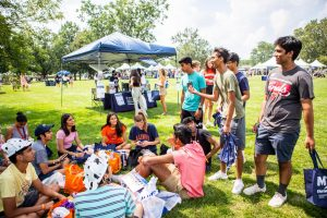 A group of University of Illinois freshman sit in a circle during the Welcome Celebration in Lot 31 after the New Student Convocation on  Aug. 20. The University reported on Wednesday  that the 2021-22 freshmen class is the largest class to be enrolled.