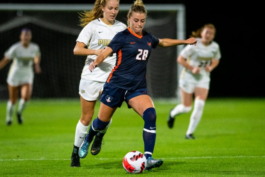 Freshman Sydney Stephens takes control of the ball during the game against Purdue on Sept. 23. The team hopes to have their first Big Ten win against Indiana on Sunday in Bloomington.