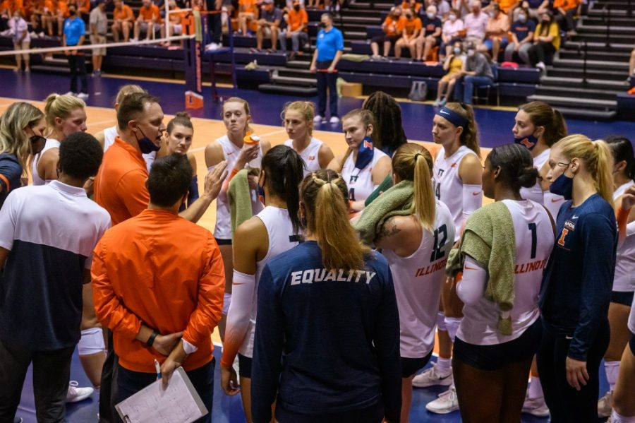 Head volleyball coach Chris Tamas speaks to his team in a huddle during their game against the University of Colorado Boulder on Sept. 4. Illinois will travel to Iowa for the Big Ten season opener and  hopes to build on their nonconference success.