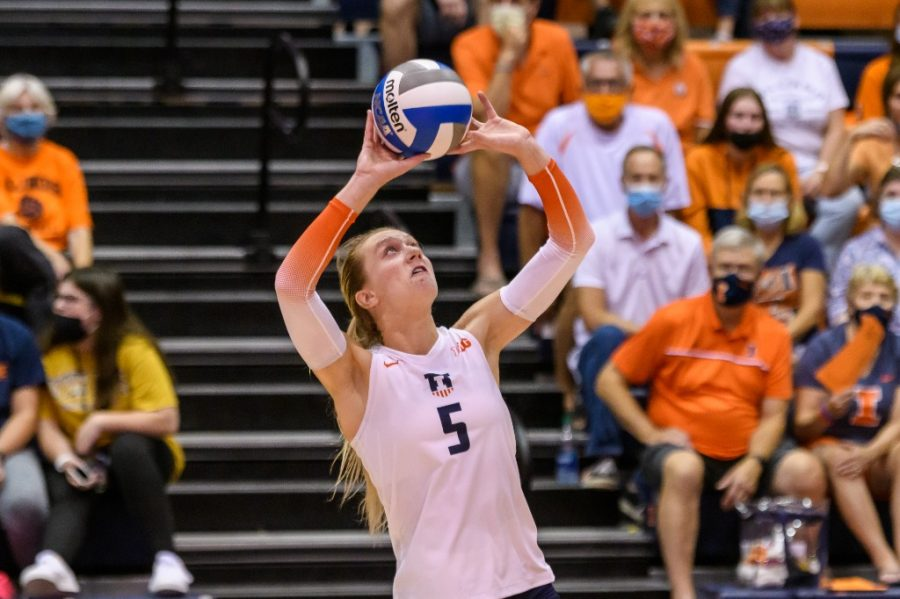 Junior Diana Brown sets the volleyball up during a game against Colorado on Sept. 4. Illinois beat Iowa on Sept. 22 with three players setting career bests.