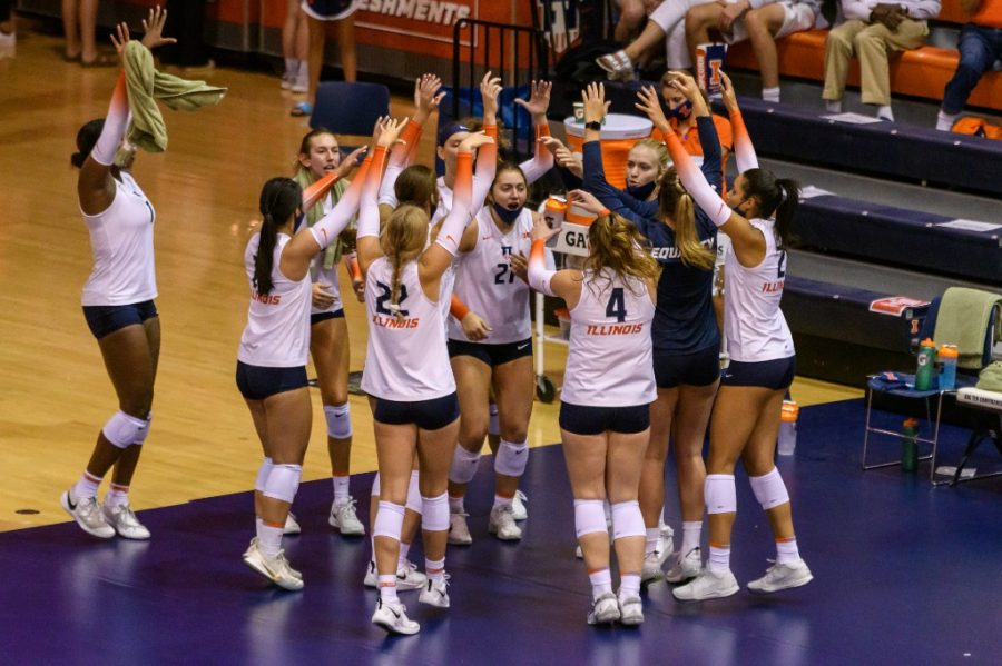 The Illinois volleyball team bands together during the game against  the University of Colorado Boulder Sept. 4. The team goes undefeated in the Redbird Classic and scores 9-0 in final three nonconference matches.