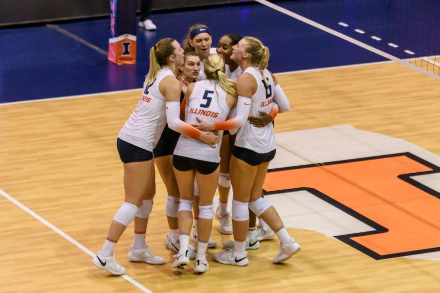 The volleyball team comes in for a hug as they finish their game against Colorado on Sept. 4. The team plays against Northwestern on Saturday in Huff Hall.
