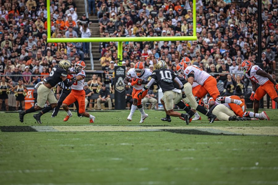 Freshman running back Josh McCray sprints through a break in the offensive at the game against Purdue on Saturday. Though McCray put together a career-best performance, struggles from quarterback Brandon Peters slowed the offense down in the 13-9 loss to the Boilermakers.
