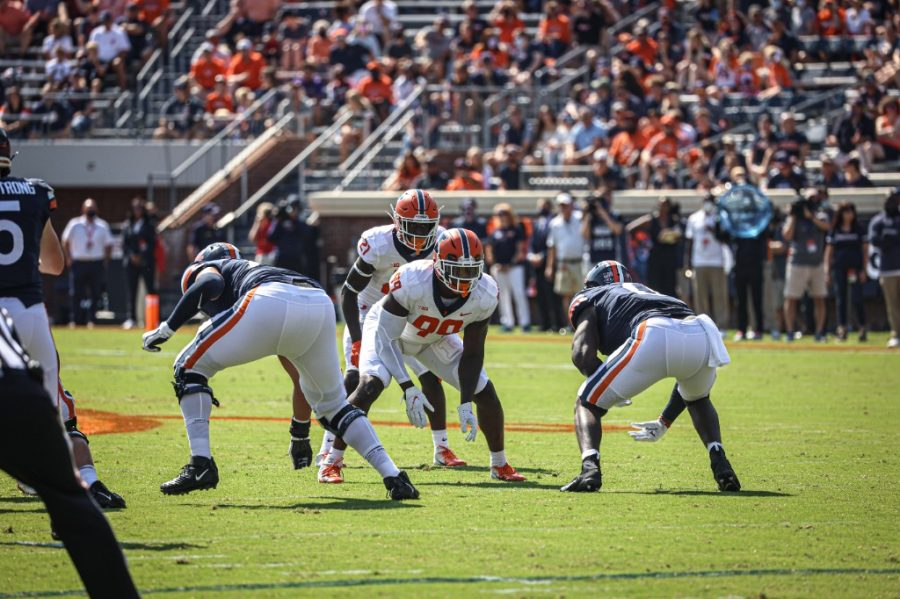 Owen Carney gets set before a play during the game against Virginia at Scott Stadium in Charlottesville on Saturday. The Illini struggled offensively and defensively against the Cavaliers, and they have lots of things to sort out before returning to Big Ten action on Friday night.