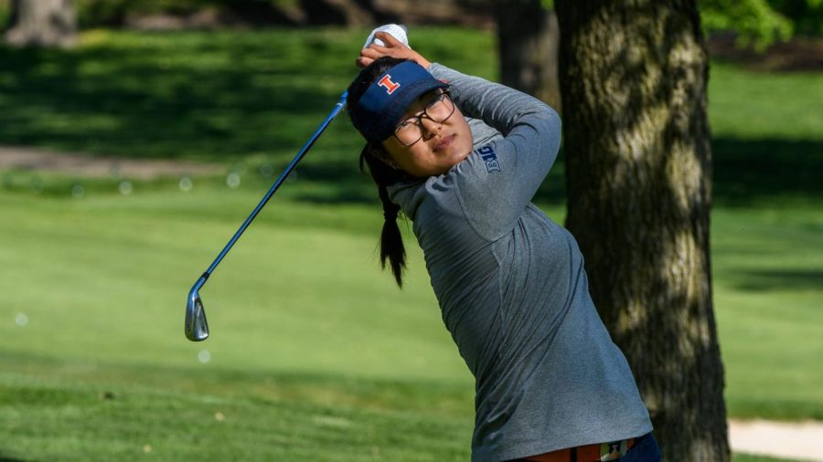Senior Crystal Wang hits the golf ball during a round of golf on May 12. Crystal Wang was the only one to play last season during COVID-19.