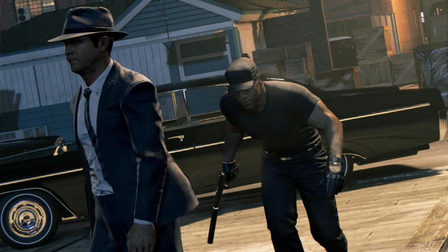 A guys sneaks up on a victim in the game Mafia III. The game was released May 19, 2020.