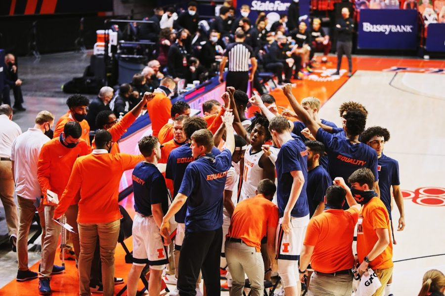 The Illinois mens basketball team huddles up during the game against Minnesota on Dec. 15. The Big Ten released the mens and womens basketball conference schedules on Wednesday.