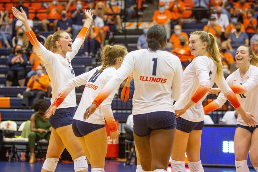 The Illinois volleyball team celebrates a point during the game against Purdue Oct. 6. The team hopes to replicate their early season successes during their rematch against Northwestern on Wednesday.