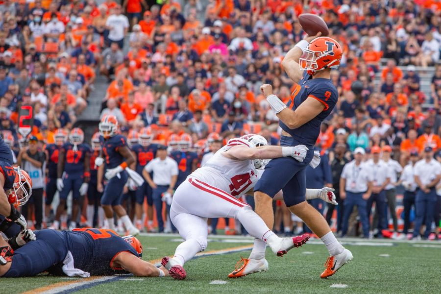 Quarterback Artur Sitkowski attempts to throw the ball during the game against Wisconsin on Oct. 9 during Homecoming Weekend. Illini football continues to struggle with their offensive line.