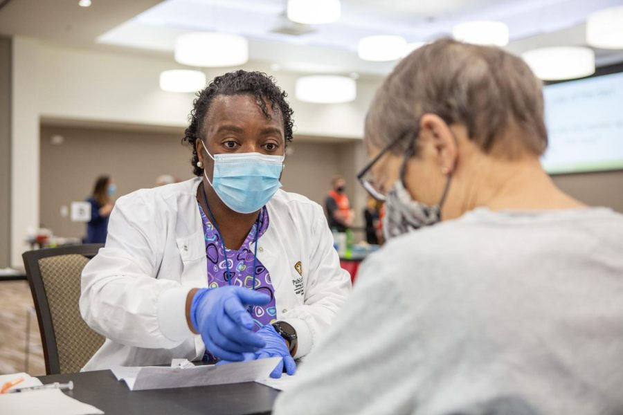 A woman administers a Moderna vaccine at the I Hotel and Conference Center on Jan. 11. Even with the pressures healthcare workers faced within the past year, students passion in pursuing this field strengthens.