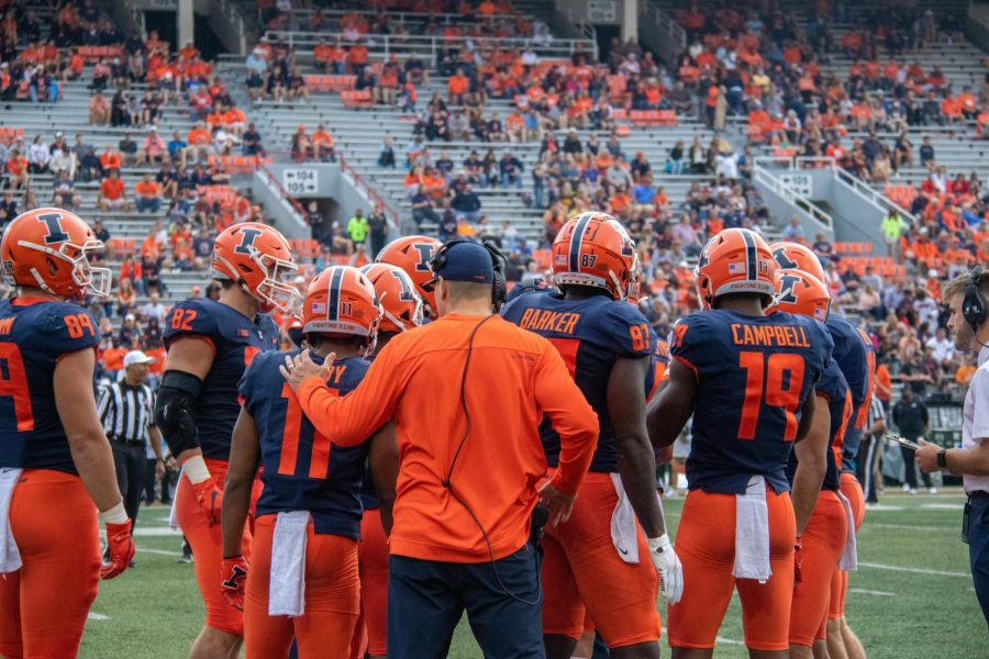 The Illini offense huddles before Saturdays game against Charlotte. Chase Browns career-high 257 rushing yards offset a dismal aerial attack in Illinois 24-14 win.