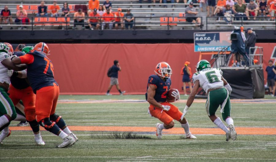 Sophomore Chase Brown runs with the ball against Charlotte on Saturday. Chase Brown worked hard to get to where he is at with his coaches pushing him hard.