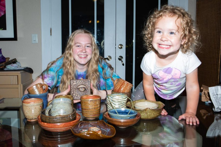 Twenty-year-old+Shaersti+Anderson+sits+with+her+daughter+Raelynn+amongst+an+assortment+of+ceramics+wearing+a+tie-dye+shirt+she+made.+Anderson%E2%80%99s+tie-dye+business+is+on+hold+but+she+hopes+to+start+it+back+up+next+year.