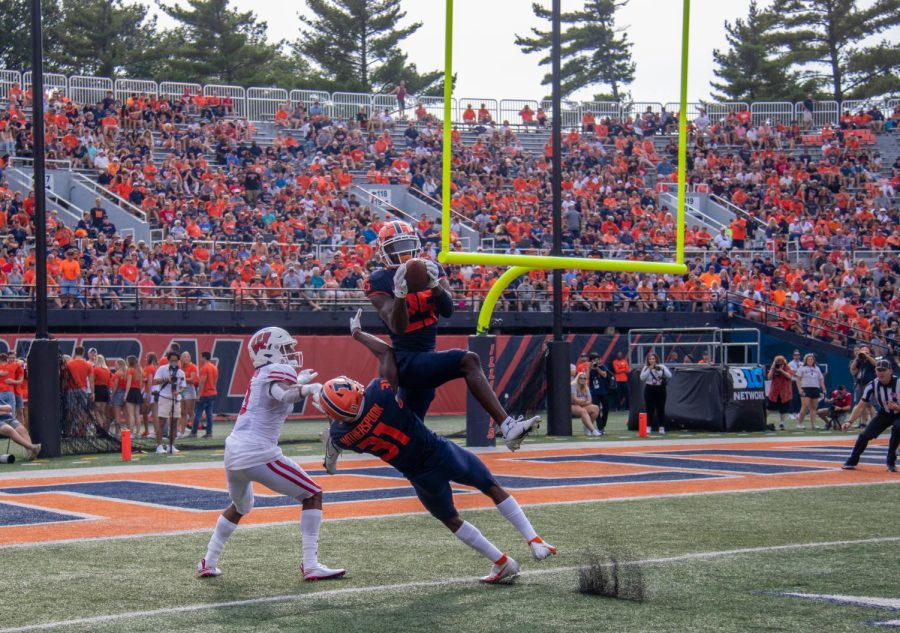 Kerby Joseph intercepts a pass from Wisconsins Graham Mertz on Saturday at Memorial Stadium. Joseph was one of the few bright spots in the Illinis ugly 24-0 loss on Homecoming weekend.