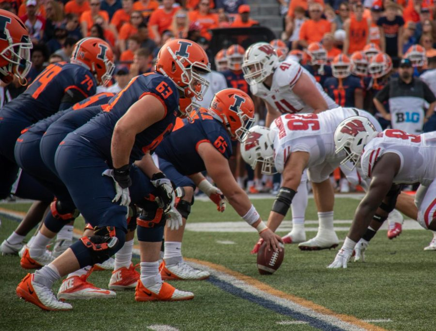 The+Illinois+offensive+line+gets+ready+to+snap+the+ball+during+the+Homecoming+game+against+Wisconsin+on+Saturday.+The+Illini+offense+and+defense+struggled+immensely+throughout+the+teams+24-0+loss+to+the+Wisconsin+Badgers.