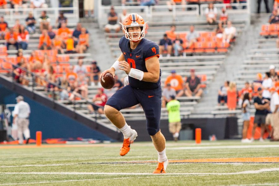 Quarterback Artur Sitkowski handles the ball during the game against Wisconsin Oct. 9.  The Illini football runnings backs remain elite while quarterbacks have a tough time.