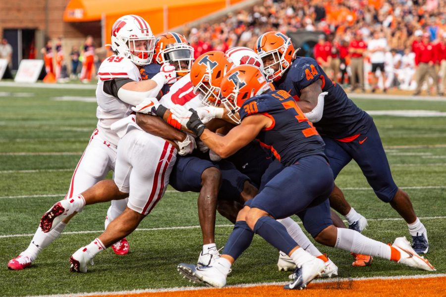 Illinois+tackles+a+Wisconsin+running+back+at+the+goal+line+in+the+second+half+of+the+Homecoming+game+against+Wisconsin.