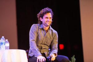 """Actor Penn Badgley and Arizona State University professor Nura Mowzoon speak to students Thursday as a part of their """"Can We Talk?"""" discourse series. The University of Illinois was the pairs first in-person stop since the pandemic to promote social change."""