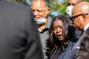 Carmen Day speaks with reporters while mourning her son Jelani Day at his funeral service on Tuesday morning. During the funeral and press conference, Days relatives and Rev. Jesse Jackson call on the Federal Bureau of Investigation and President Joseph Biden for justice.