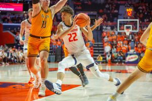 Austin Hutcherson drives to the rim during the second half of the game against St. Francis (Ill.) at State Farm Center on Saturday night. Hutcherson stood out in his Illinois debut, recording 14 points and seven rebounds in the 101-34 win.