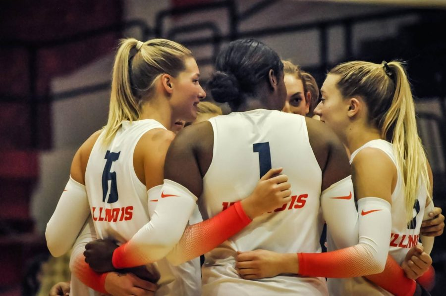 Illinois huddles during the match against Northwestern on Sept. 25 at Huff Hall. The Illini fell to the Wisconsin Badgers, 3-1, in Madison on Saturday night.