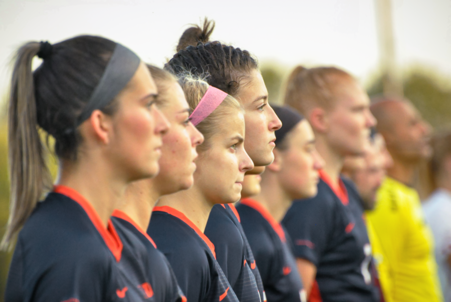The Illinois soccer team stand on the sidelines for the national anthem during the game against Wisconsin on Oct. 8. The Illini fell 5-0 against Minnesota tonight to their strong leading attack.