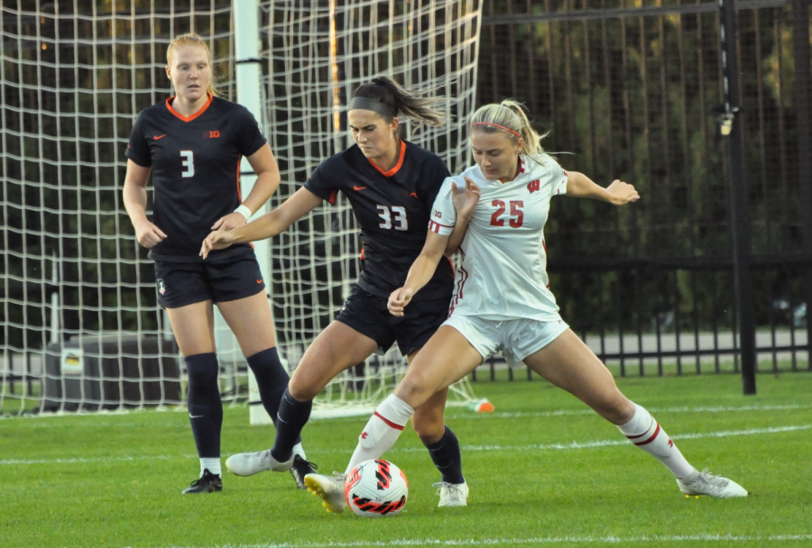 Redshirt Junior Ashley Cathro defends the all during the game against Wisconsin Oct. 8. The Illini fell to Iowa 3-2 on Sunday afternoon.