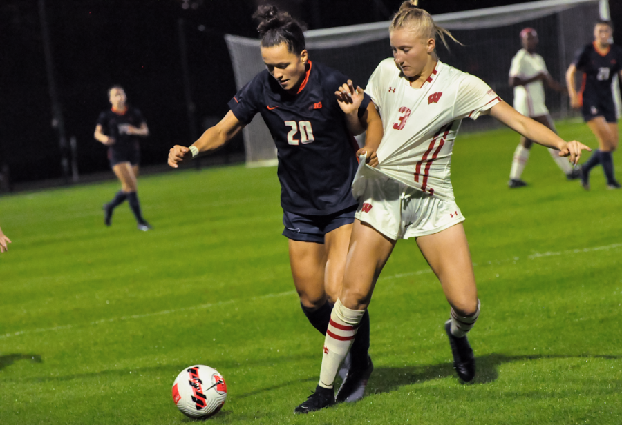 Senior Makena Silber kicks the soccer ball during their game against Wisconsin on Saturday. The teams tie after going into two different overtimes.