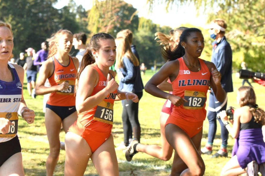 Two members of the Illinois cross country team run during the Joe Piane Invitational on Oct. 1. The team will be heading to Tallahassee, Florida for the upcoming NCAA Pre-Nationals meet on Friday in hopes of a strong start to the season.