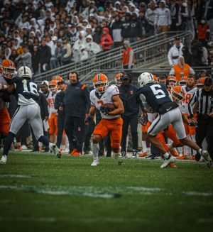 Illinois running back Chase Brown carries the ball during the first half of the game against Penn State at Beaver Stadium on Saturday.