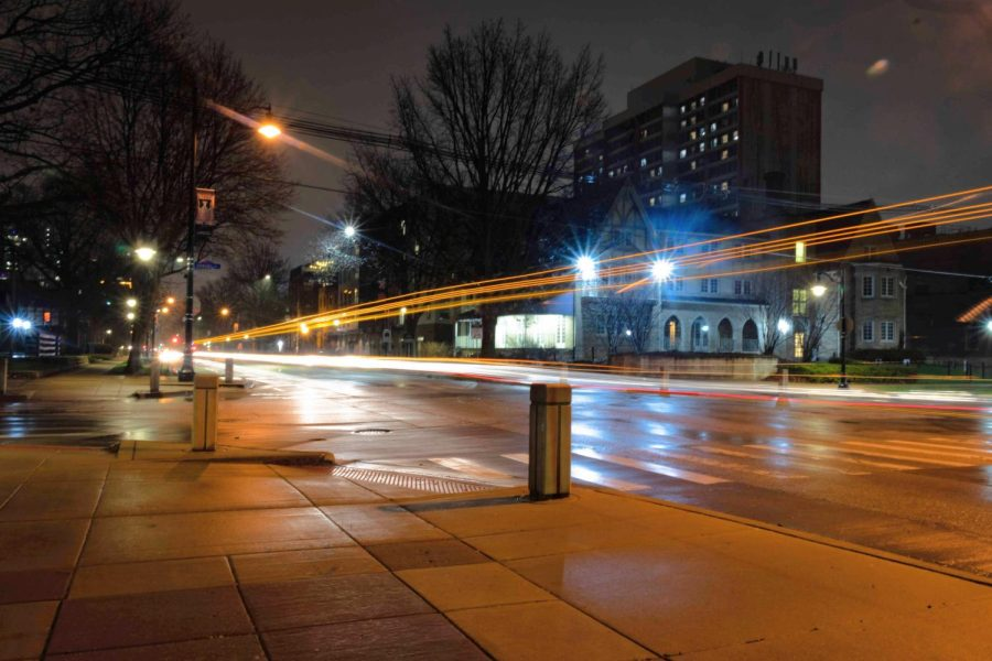 A light trail from a MTD bus occupies the intersection of Armory and Fourth streets on March 26, 2020 soon after student left campus due to the start of the Covid-19 pandemic. University seniors feel they have missed out on the college experience because of the pandemic.