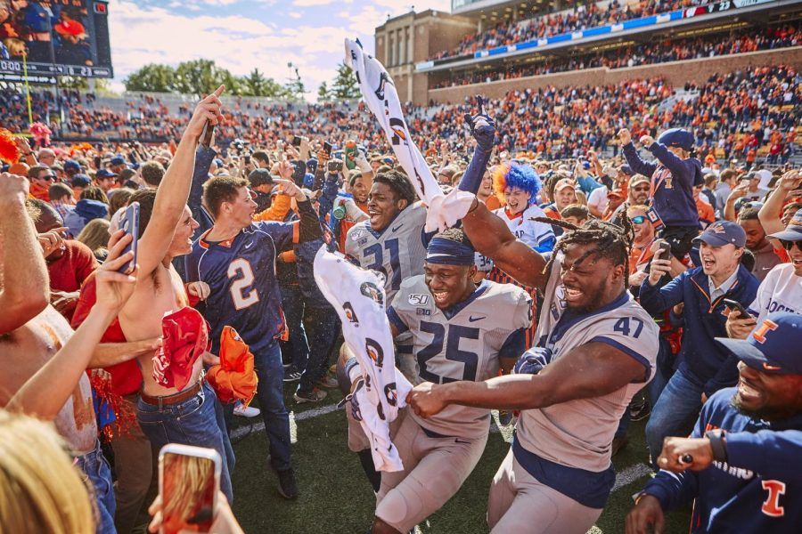 Illini football players Devon Witherspoon, Kerby Joseph, and Oluwole Betiku Jr. celebrate after their homecoming win against Wisconsin Oct. 19, 2019. The Illini hope to replicate that magical win for the second time against the Badgers Oct. 9.
