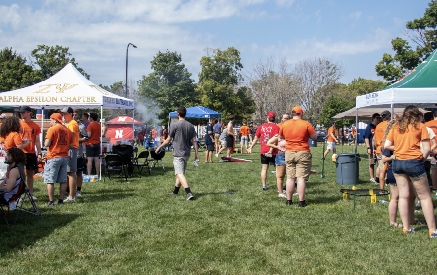 Groups of people tailgate with friends and family in Grange Grover before the Illini football game against Nebraska Aug. 31. Multiple Greek life, Athletics, and departmental tailgates will be hosted during the homecoming game against Wisconsin Oct. 9.