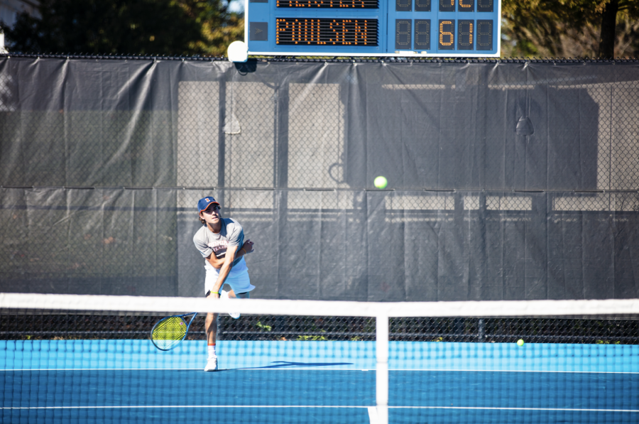 Redshirt junior Nic Meister serves the ball during the Fighting Illini Invite Sunday. The team saw mixed results over the weekend.