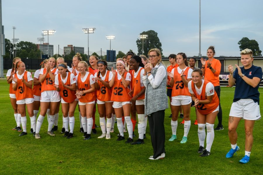 Coach Janet Rayfield stands with her team as they cheer before their game against Xavier on Sept. 2. Coach Rayfield just achieved the 100 Big Ten win with the soccer team.