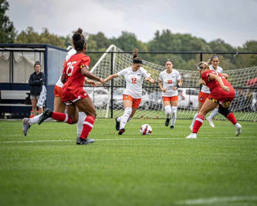 Junior Kendra Pasquale takes control over the soccer ball against Maryland on Oct. 3. The team plays against the Wisconsin Badgers on Friday in hopes of beating them and achieving their second win in a row.